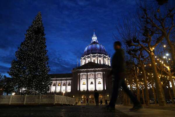 San Francisco City Hall is lit with white and blue lights on New Year's Eve in San Francisco, Calif., on Sunday, December 31, 2017.