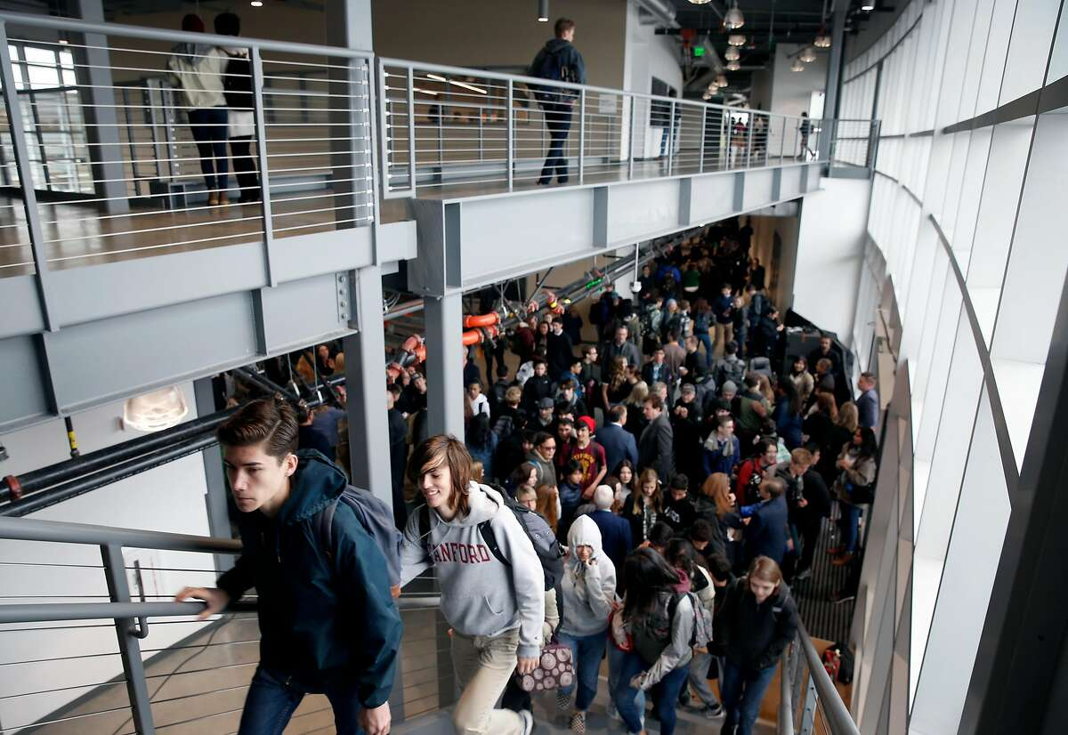 Students explore the new Design Tech High School for the first time after a ribbon cutting ceremony to celebrate its opening on the Oracle campus in Redwood City, Calif. on Tuesday, Jan. 9, 2018.