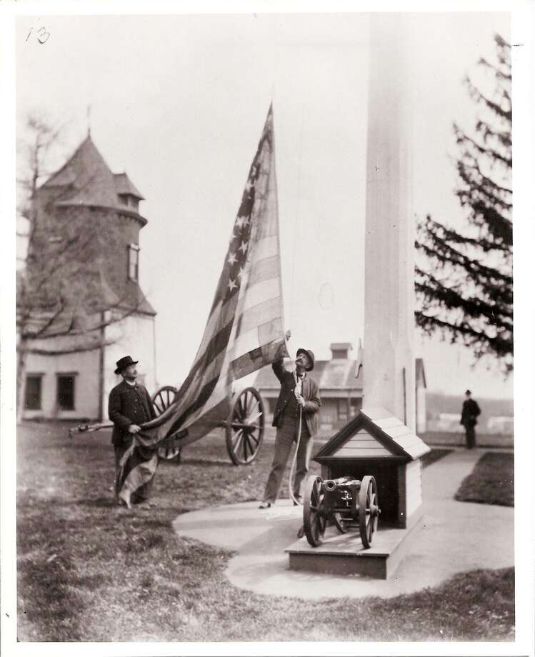 Photographs, such as this one showing the raising of a flag at Fitch's Home for Soldiers, are on display at the Darien Historical Society through March 13. Photo: Contributed / Contributed Photo