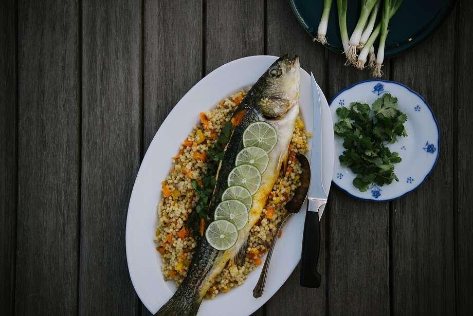 Turmeric-baked sea bass with saffron couscous. Photo: Nik Sharma