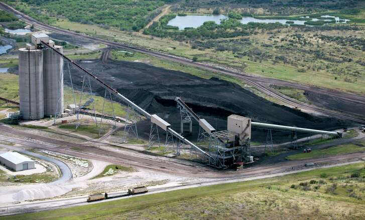 The on-site lignite coal pile for the San Miguel power plant near Campbellton, Texas is seen in this Wednesday, May 17, 2017 aerial photo. The lignite is strip-mined just a few miles from the plant. (William Luther / San Antonio Express-News)