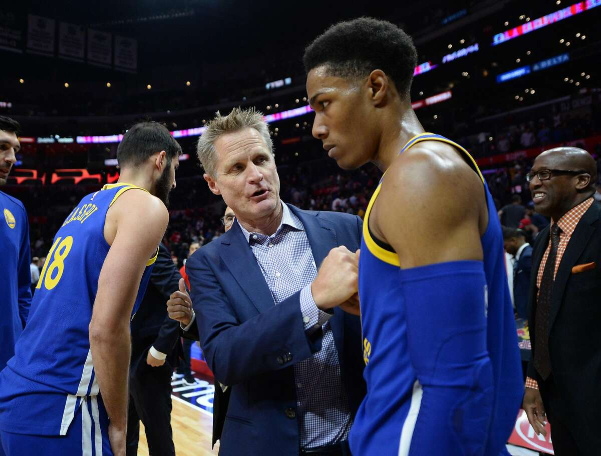 LOS ANGELES, CA - OCTOBER 30: Steve Kerr coach of the Golden State Warriors talks with point guard Patrick McCaw #0 after the basketball game against Los Angeles Clippers at Staples Center October 30 2017, in Los Angeles, California. NOTE TO USER: User expressly acknowledges and agrees that, by downloading and or using this photograph, User is consenting to the terms and conditions of the Getty Images License Agreement. (Photo by Kevork Djansezian/Getty Images)