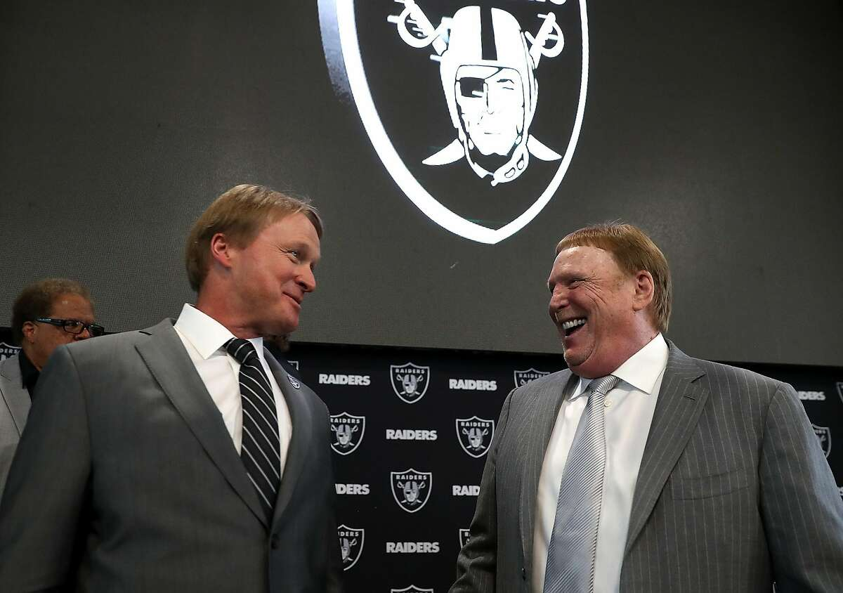 ALAMEDA, CA - JANUARY 09: Oakland Raiders new head coach Jon Gruden (L) talks with Raiders owner Mark Davis during a news conference at Oakland Raiders headquarters on January 9, 2018 in Alameda, California. (Photo by Justin Sullivan/Getty Images)