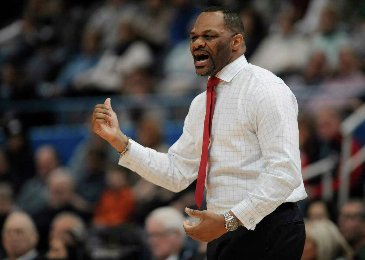 Houston head coach Ronald Hughey calls out to his team in the half of an NCAA college basketball game against Connecticut, Saturday, Jan. 28, 2017, in Hartford, Conn. (AP Photo/Jessica Hill)