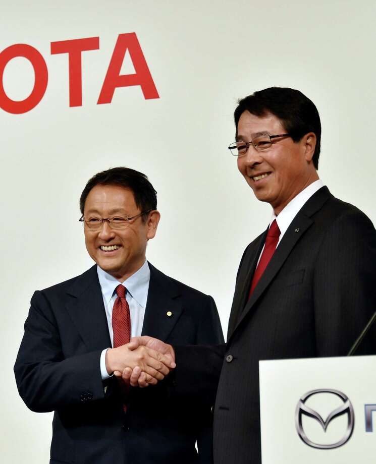 File photo of Toyota Motor president Akio Toyoda (L) with Mazda Motor president Masamichi Kogai (R) in Tokyo. The companies reportedly settled on Alabama for the location of their new joint manufacturing facility. Photo: YOSHIKAZU TSUNO /AFP / Getty Images / AFP