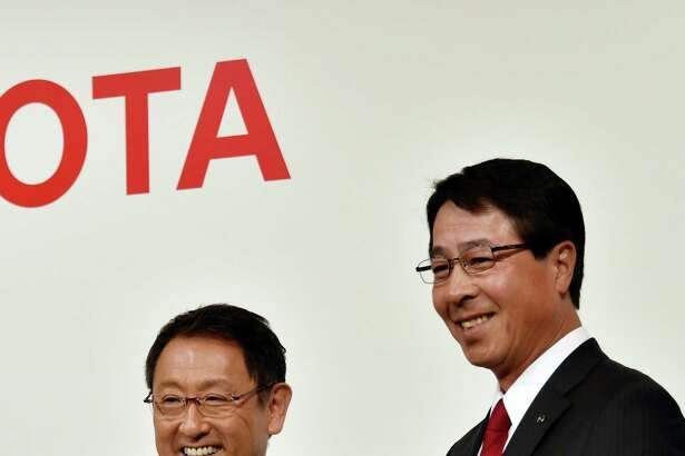 File photo of Toyota Motor president Akio Toyoda (L) with Mazda Motor president Masamichi Kogai (R) in Tokyo. The companies reportedly settled on Alabama for the location of their new joint manufacturing facility.
