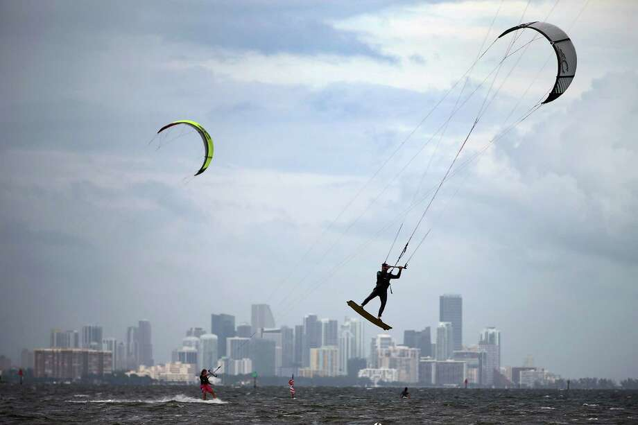 MIAMI, FL - OCTOBER 24:  Santiago Porteiro (R) and others take advantage of the winds from the outerbands of Hurricane Sandy to kite surf on October 24, 2012 in Miami, Florida. After passing over Jamaica, Sandy is expected to hit eastern Cuba on Wednesday night and into the Bahamas Thursday and Friday, a tropcial storm warning was issued for east coast of Florida from Ocean Reef to Sebasian Inlet and a tropical storm watch was extended along the east coast to Flagler Beach. Photo: Joe Raedle, Getty Images / 2012 Getty Images
