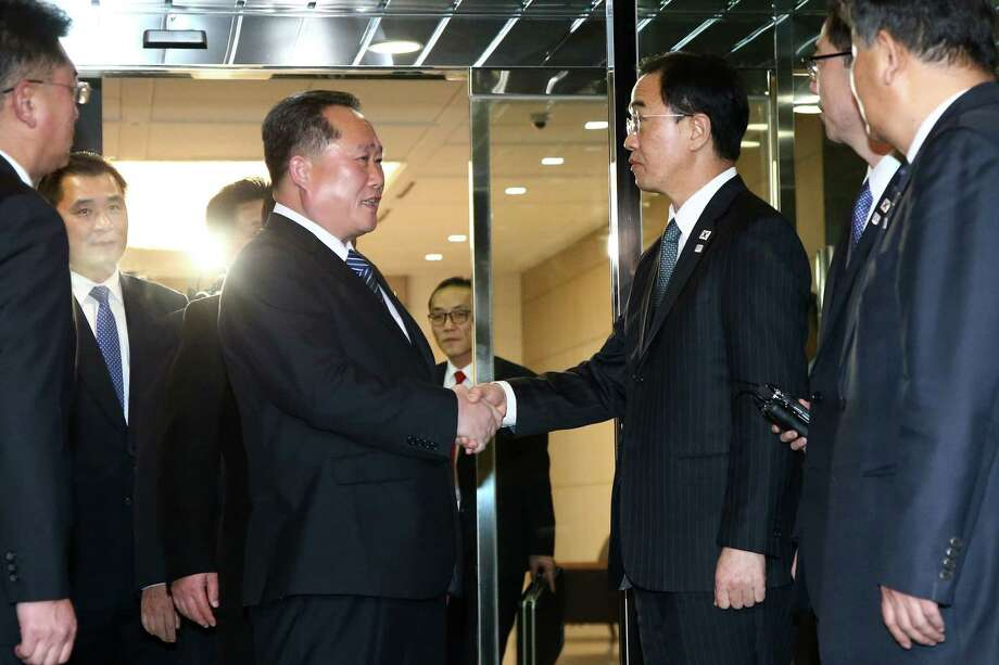 The head of North Korean delegation, Ri Son Gwon, left, shakes hands with South Korean Unification Minister Cho Myoung-gyon after their meeting at Panmunjom, South Korea Tuesday. Photo: POOL / ????? ???? ?? ???