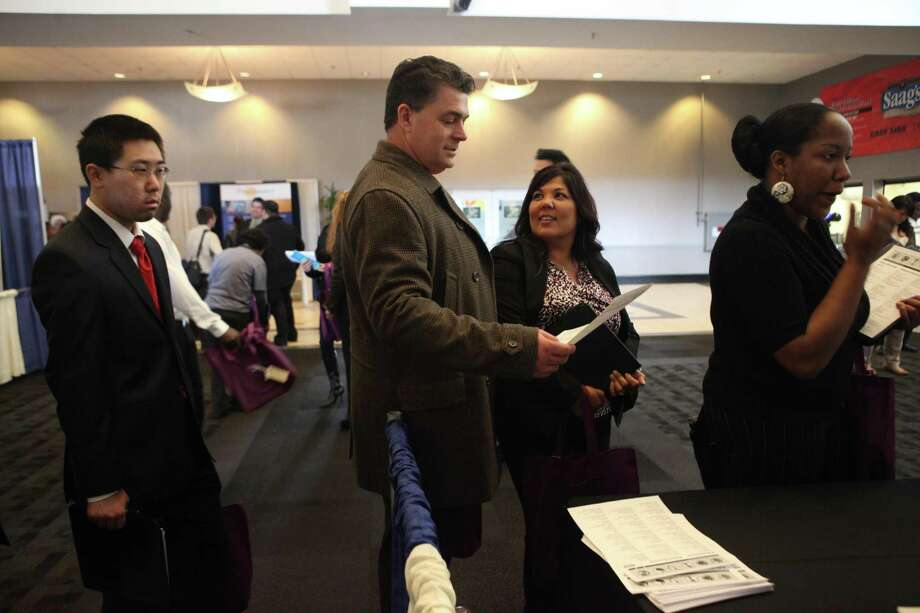 This file photo shows a California job seeker talking to a Kelly Services' recruiter. San Antonio-based InGenesis has acquired Kelly Services' health care specialty business. Photo: Lea Suzuki /The Chronicle / ONLINE_YES