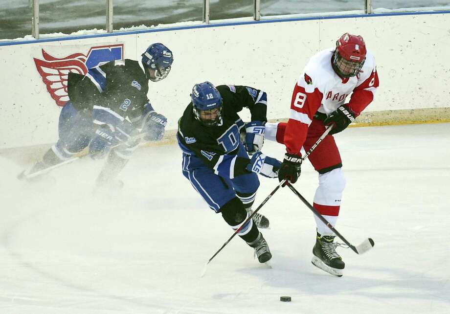 Greenwich Alex Mozian (8) fights for the puck against Darien Max Sharp (12) during the first annual Winter Classic hockey game at the Greenwich Skating Club in Greenwich, Conn. on Saturday, Dec. 30, 2017. Photo: Matthew Brown / Hearst Connecticut Media / Stamford Advocate