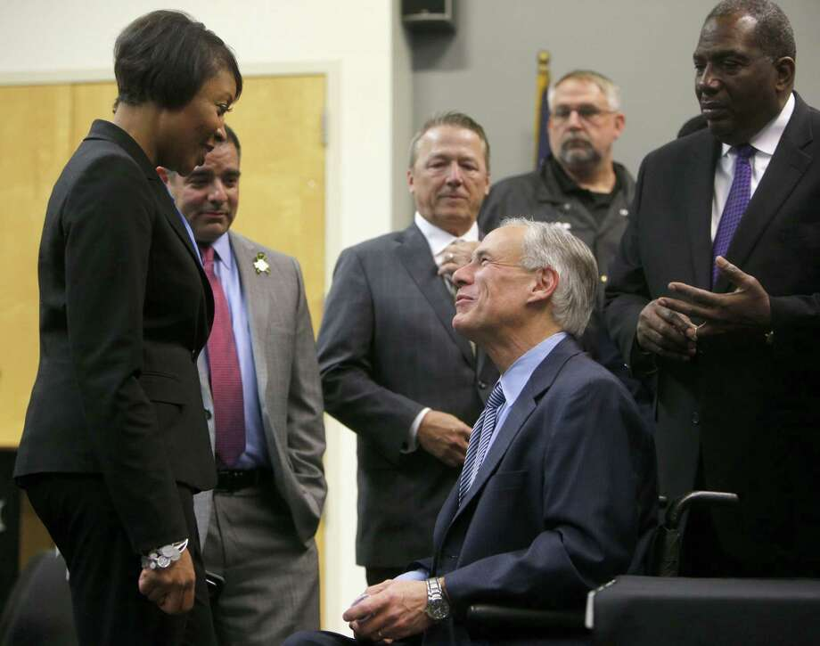 Texas Governor Greg Abbott speaks to Dallas Police Chief U. Renee Hall before a press conference to announce the grant funding for rifle proof vests for Texas police officers at Dallas Police Association Headquarters in Dallas on Tuesday, Jan. 9, 2018. (Rose Baca/The Dallas Morning News) Photo: Rose Baca, Staff Photographer / Staff Photographer / Rose Baca, The Dallas Morning News