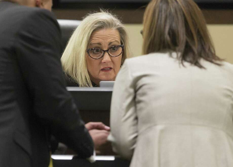 State District Court Judge Melisa Skinner speaks with attorneys in 2015. Skinner, a quality jurist, is among the casualties of blue-wave voting this election. Photo: Staff File Photo / © 2018 San Antonio Express-News