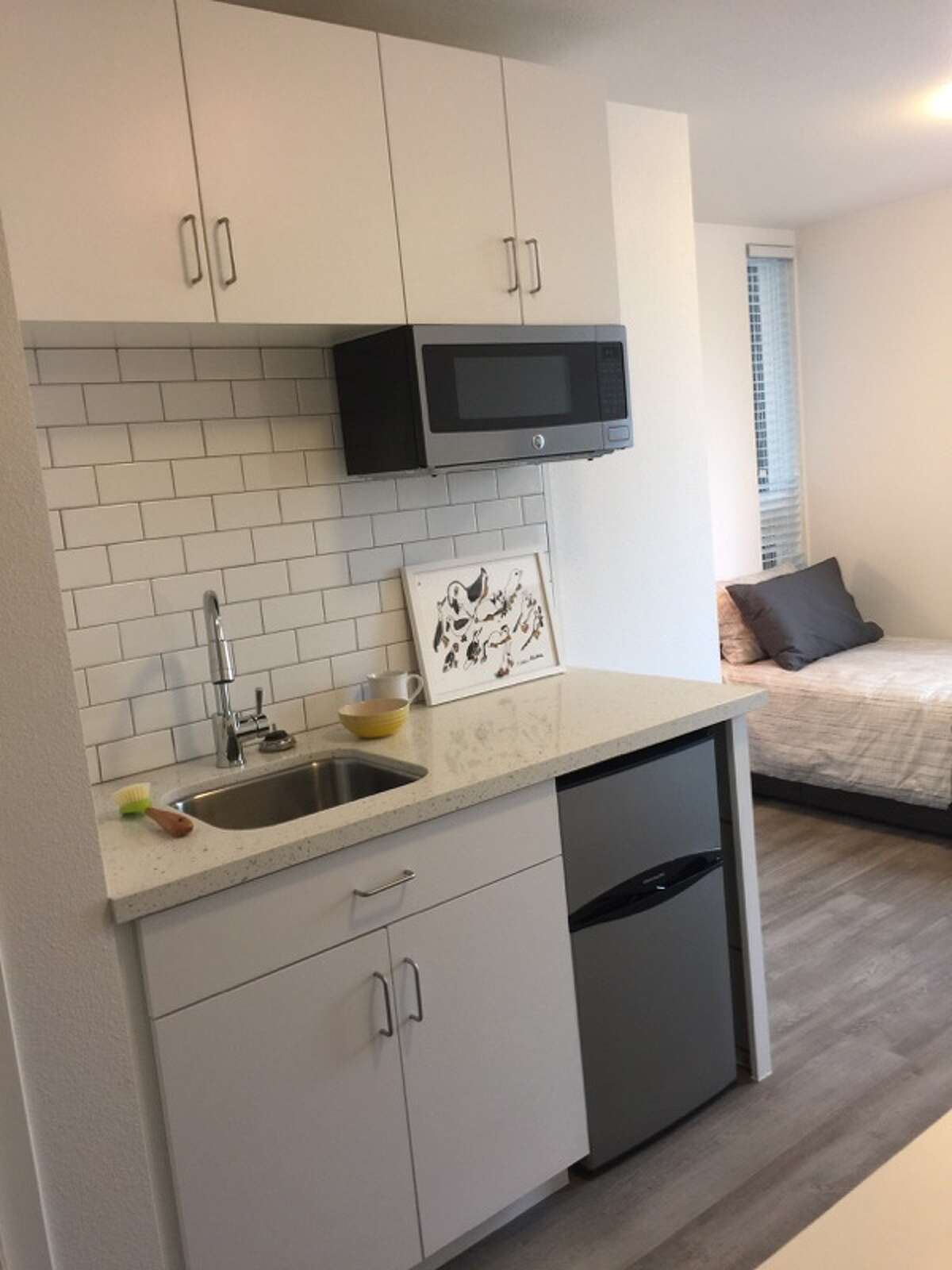 Each micro-apartment has a kitchenette with a mini-fridge and microwave. Any heavy-duty cooking will have to happen in the shared kitchen on each floor.