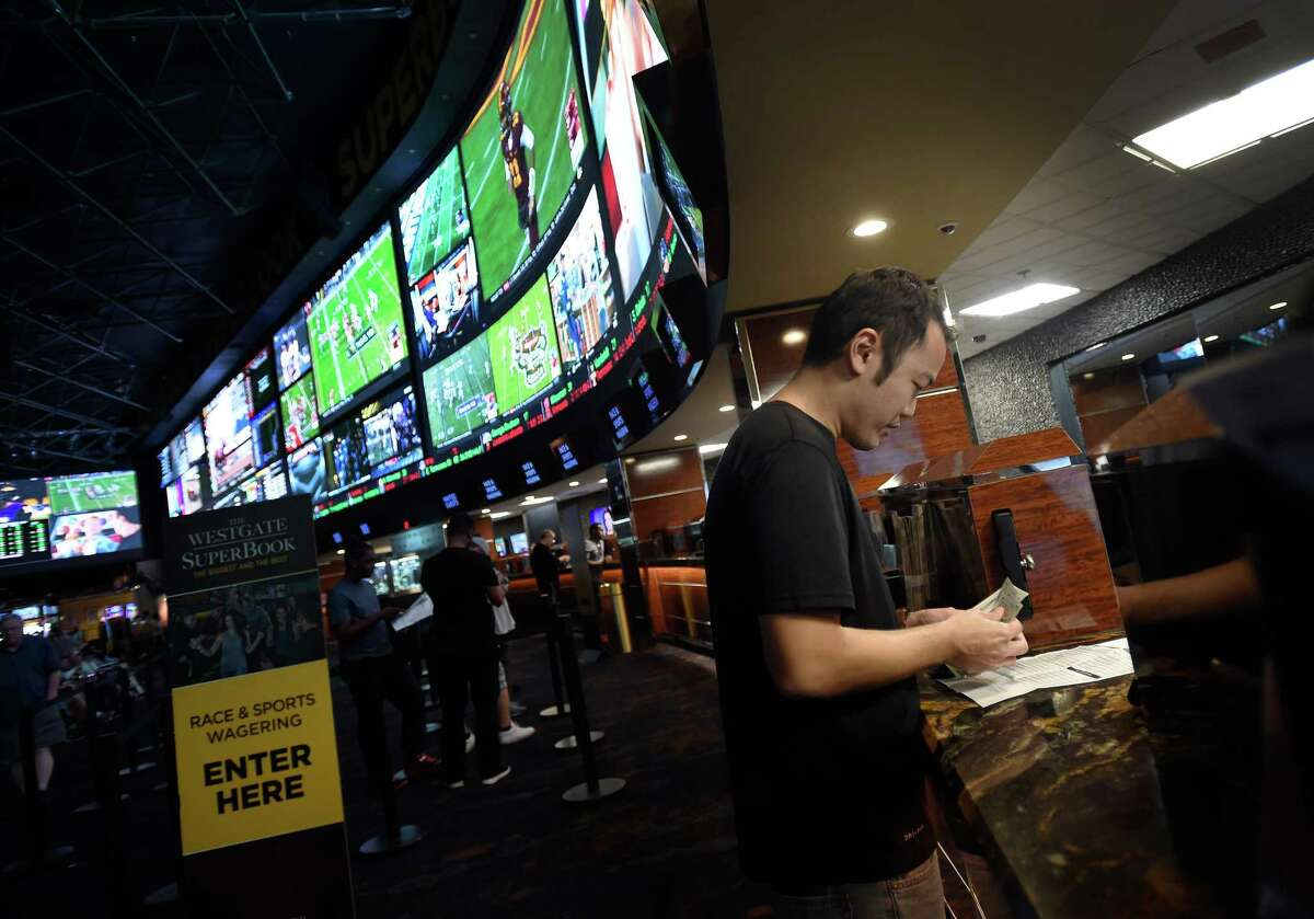 A customer makes a sports bet at the Race & Sports SuperBook in Las Vegas. Many see the eventual expansion of legal sports betting as a given. MUST CREDIT: Photo for The Washington Post by David Becker