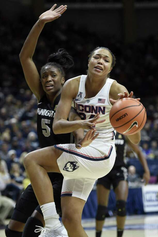 UConn's Napheesa Collier battles for a rebound with UCF's Masseny Kaba (5) during the first half on Tuesday. Photo: John Woike / TNS / Hartford Courant