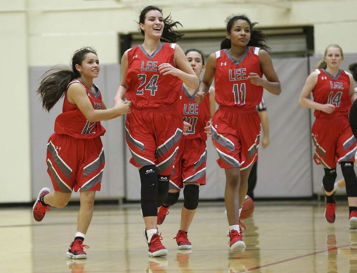Lee players: Jenesis Navarro (from left), Leslie Velten, Blanca DeLeon, Keamber McCracken and Mariel Prevost react as they head toward the sidelines after a timeout against Johnson in girls basketball at Littleton Gym on Tuesday, Jan. 8, 2018. Lee defeated Johnson, 76-51, in district play. (Kin Man Hui/San Antonio Express-News)