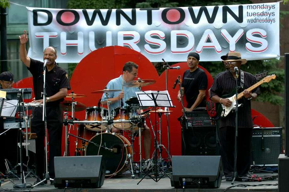 The Special O Band performed in the first Downtown Thursdays concert series on McLevy Green in downtown Bridgeport, Conn. on Thursday July 01, 2010. Here, Bridgeport Police Chief Joe Gaudett makes an appearance for a few songs on drums with the band. Photo: Christian Abraham / Connecticut Post