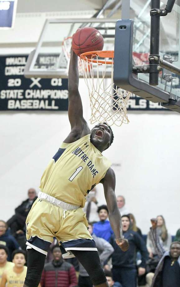 Damion Medwinter of Notre Dame makes a slam dunk during SWC basketball action between Immaculate and Notre Dame-Fairfield at Immaculate, Jan. 9, 2018. Photo: Krista Benson / The News-Times Freelance