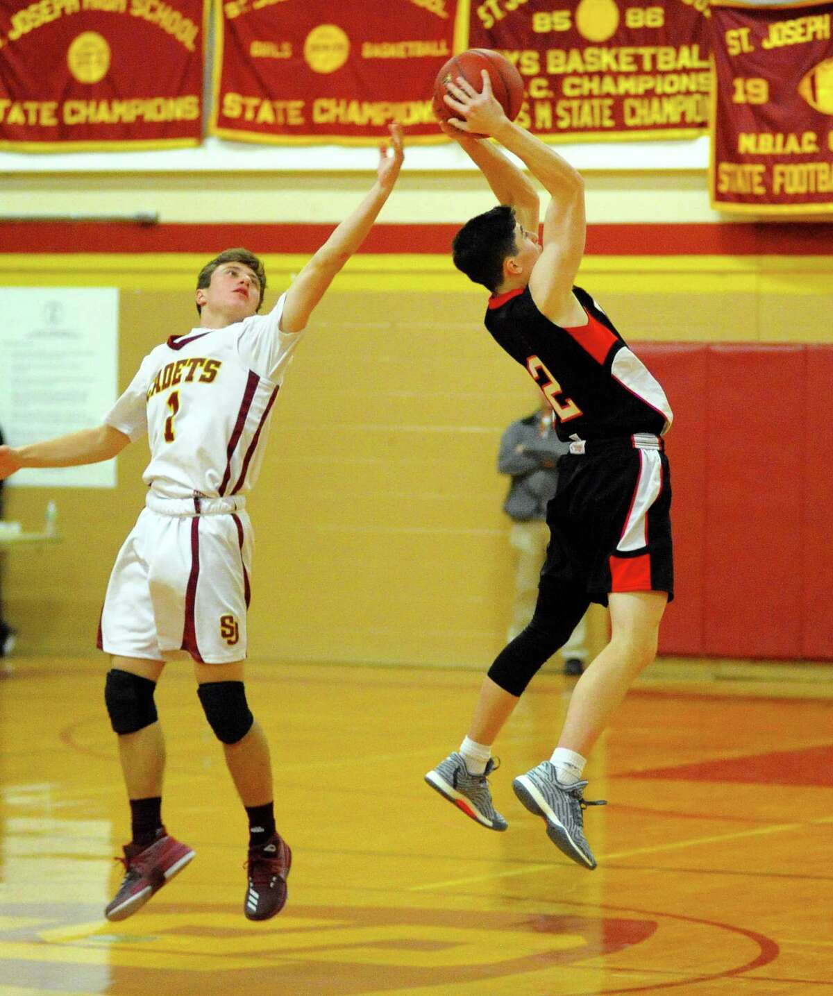 Fairfield Warde's Daniel Fitzpatrick, right, intercepts a pass sent to St. Joseph's Ace Luzietti during basketball action in Trumbull, Conn., on Tuesday Jan. 9, 2018.