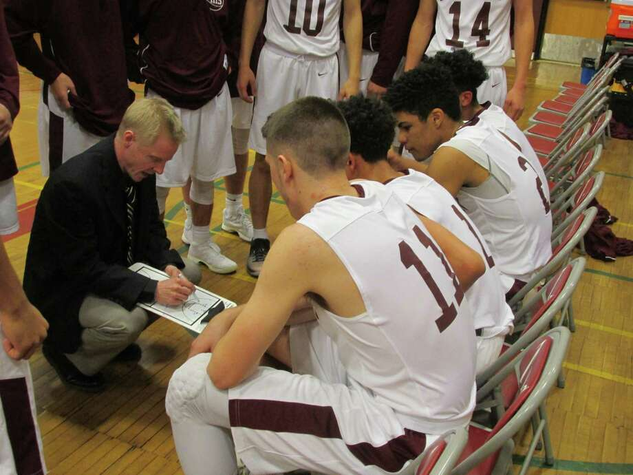 Torringon coach Eric Gamari draws a new plan against Ansonia to pull away after a tough first quarter Tuesday at Torrington High School. Photo: /