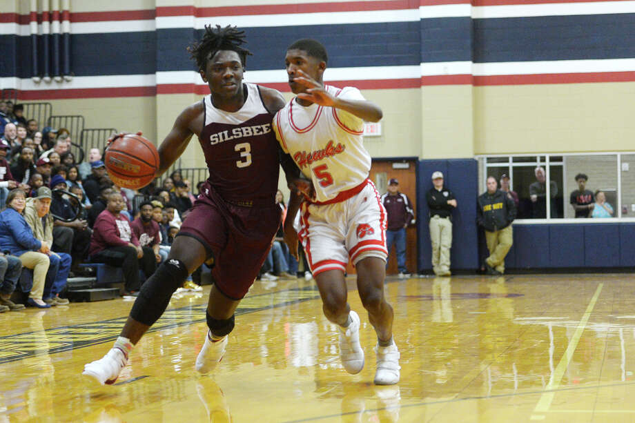 Silsbee's Devon McCain is defended by Hardin-Jefferson's Bruce Green during their game at Hardin-Jefferson High School on Tuesday evening.  Photo taken Tuesday 1/9/18 Ryan Pelham/The Enterprise Photo: Ryan Pelham / ©2017 The Beaumont Enterprise/Ryan Pelham
