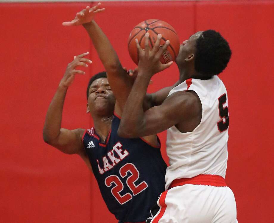 Clear Lake's Zaid Harris, left, tries to stop Clear Brook's Kendrick Christian, who led the Wolverines with 20 points Tuesday night. Photo: Steve Gonzales, Houston Chronicle / © 2018 Houston Chronicle