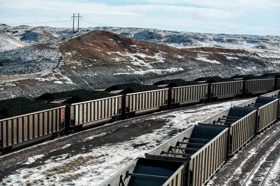 Railcars are filled with coal and sprayed with an agent to suppress dust at Cloud Peak Energy's Antelope Mine north of Douglas, Wyo. President Trump has vowed to boost the coal industry. Photo: Ryan Dorgan, MBR / The Advocate
