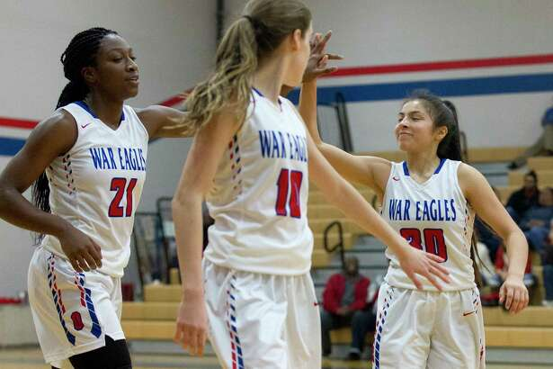 Oak Ridge small forward Alecia Whyte (21) gets a high-five from guard Alyssa Gonzales (30) as guard Maddie Morris (10) looks on during the third quarter of a non-district high school girls basketball game at Oak Ridge High School, Friday, Dec. 8, 2017.