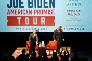 Former Vice President Joe Biden gets a standing ovation as he takes the stage with University of California President and former United States Secretary of Homeland Security Janet Napolitano at the San Francisco Jewish Community Center in San Francisco, Calif., on Tuesday, January 9, 2018.