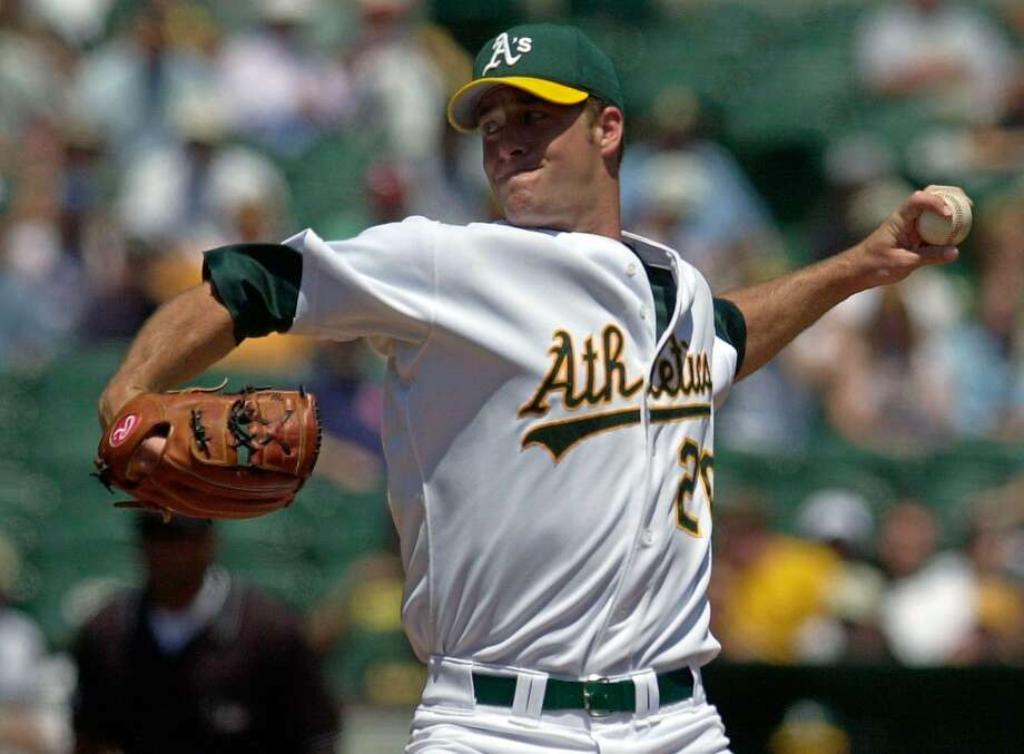 Oakland Athletics pitcher Mark Mulder delivers against the Cleveland Indians during the first inning Wednesday, July 31, 2002 in Oakland, Calif. Mulder recovered from a rocky second inning to win for the 10th time in 13 starts. (AP Photo/Julie Jacobson) Photo: JULIE JACOBSON, AP