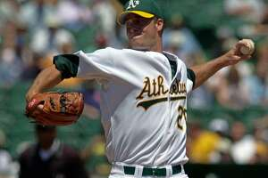 Oakland Athletics pitcher Mark Mulder delivers against the Cleveland Indians during the first inning Wednesday, July 31, 2002 in Oakland, Calif. Mulder recovered from a rocky second inning to win for the 10th time in 13 starts. (AP Photo/Julie Jacobson)