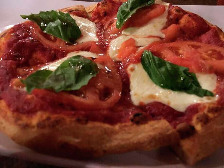 Fresh mozzarella, tomatoes, G's 'secret pizza sauce' and a few fresh basil leaves make the margherita pizza so delicious at G's Pizzeria, 1005 Saginaw Street across the Veteran's Memorial Bridge on Bay City's east side. (Photo by Matthew Woods)