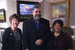 Gallery 25 on Railroad Street in New Milford recently celebrated its fourth anniversary. The milestone was recognized during the New Milford VNA & Hospices Sip & Stroll event Dec. 1. Mayor Pete Bass helped gallery officials, including gallery director Diane Dubreuil, left, and Linda Breen, chairwoman of the New Milford Commission on the Arts. The gallery moved from 25 Church St. to its new location in the railroad station earlier this year. The gallery features all fine art and artisan works by 21 juried local and regional artists. The gallery is sponsored by New Milford Commission on the Arts.