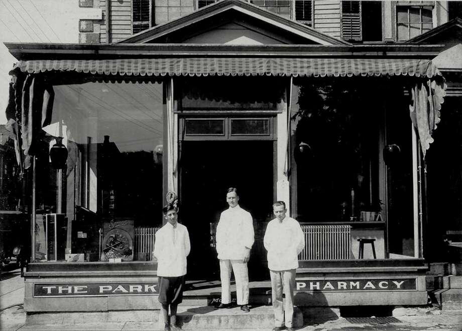 "Gif Noble, center, the druggist and owner of the former Park Pharmacy in New Milford, poses to be photographed with two young men, identity unknown, in the early years of the business, likely the late 1920s or early 1930s. The Park Pharmacy was located at the corner of Main and Bank streets in New Milford, later to be succeeded on the same site by the Slone Pharmacy, the New Milford Pharmacy and Biy Y Pharmacy. The United States Hotel had anchored the busy corner site along the Village Green for many years. If you have a ""Way Back When"" photo to share, contact Deborah Rose at drose@newstimes.com or 860-355-7324. Photo: Contributed Photo / Contributed Photo / The News-Times Contributed"