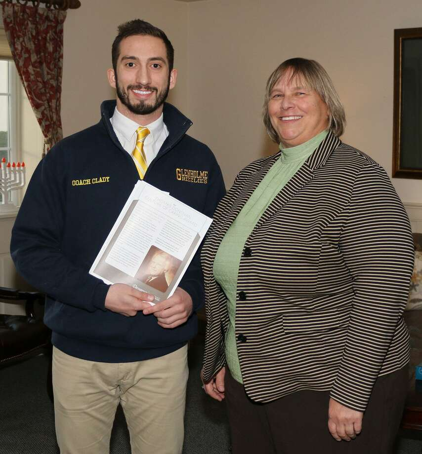 The Glenholme School in Washington, a special needs boarding and day school for students with social, emotional and learning challenges, recently honored Matt Clady, left, with the Devereux's Thomas Donovan Culture of Giving Award for his contributions. Clady was presented the award by Judy Cooper, the school's assistant executive director, right. Clady joined Glenholme's faculty in August of 2011. In his role, he consistently strives to deliver quality instruction, while maintaining the highest level of care to students, according to school officials. Clady also manages the athletics program, as well as furthers his duties as a part-time supervisor. Photo: Courtesy Of Glenholme School / The News-Times Contributed