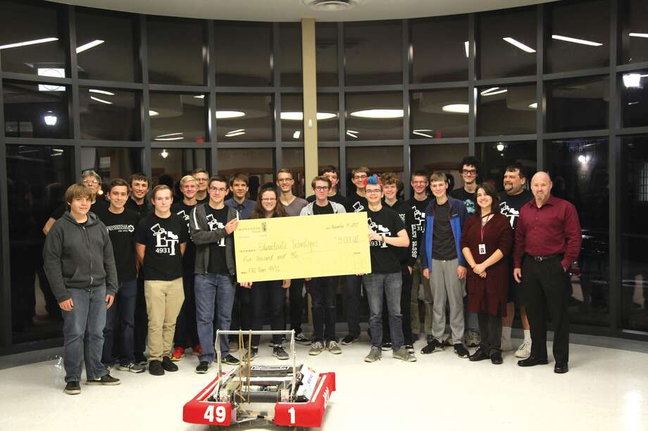 Local robotics team FRC #4931, The Edwardsville Technologies, receives their $5,000 Monsanto grant. This team is part of the Edwardsville Robotics Club and they received this grant towards this year's upcoming season. Photo: For The Intelligencer