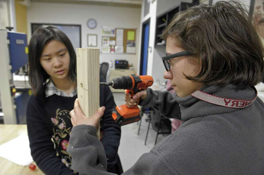 Freshman Margaux Barthelemy, 14, right, and Maggie Xiang, 14, work on a trebuchet in their robotics class at The Gunnery on Friday  in Washington . Photo: H John Voorhees III / Hearst Connecticut Media / The News-Times