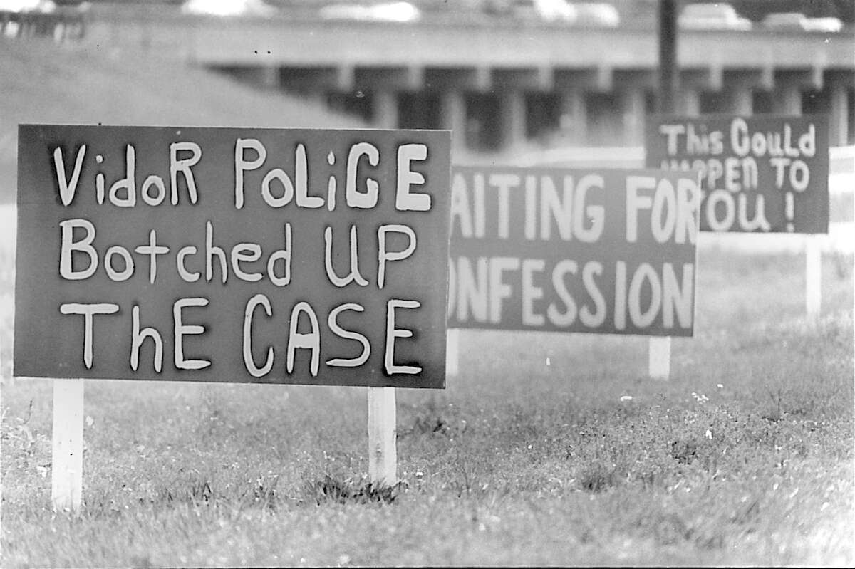 Three of several signs along Interstate 10 alleging problems with Vidor Police's investigation into the 1991 murder of Kathy Page. Photo dated April of 1994 Beaumont Enterprise archive photo