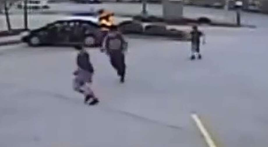 Deputies in the Spring Cypress area are trying to figure out why two teenagers were caught on camera shoving another teenager into the trunk of a car on Monday.   The Harris County Sheriff's Office has released video of the incident, which occurred in the parking lot of a Popeye's restaurant at 22534 Tomball Parkway, at about 6:15 p.m. on Jan. 8. Photo: Harris County Sheriff's Office
