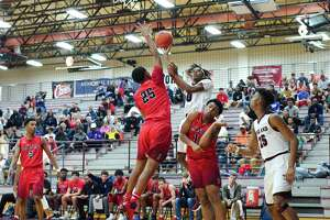 Pearland's Robert Charles (0) puts up a shot over Dawson's Jordan Marshall (25) Tuesday, Jan 9 at Pearland High School.