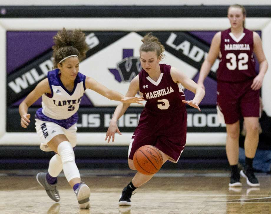 Magnolia's Tia Frederick (3) and Willis' Mersadez Nephew (5)  goes for a loose ball after Frederick knocked the ball out of Newphew's hands during the second quarter of a District 20-5A high school girls basketball game at Willis High School, Tuesday, Jan. 9, 2018, in Willis. Photo: Jason Fochtman/Houston Chronicle