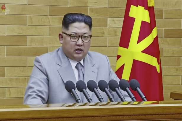 FILE - In this image made from video released by KRT on Jan. 1, 2018, North Korean leader Kim Jong Un speaks in his annual address in undisclosed location, North Korea. North Korea is starting off the new year with a fresh diplomatic initiative aimed at wooing South Korea ahead of its hosting of next month's Winter Olympics. But it's sticking to a decidedly harsh _ and familiar _ message for U.S. President Donald Trump: back off and let Koreans solve their own problems. (KRT via AP Video)