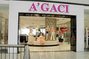 The A'Gaci women's clothing store at the Deerbrook Mall in Houston. The San Antonio-based retailer disclosed it will be closing 49 of its 78 stores, including its shop in the Rollling Oaks Mall.