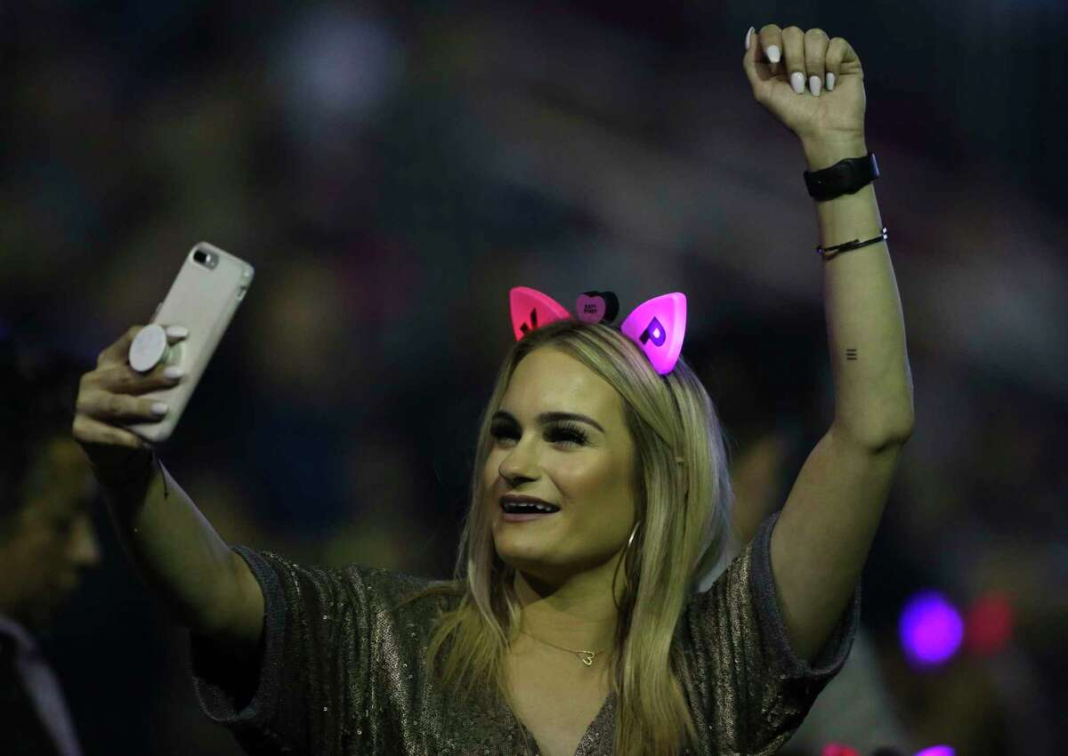 """A Katy Perry fan takes a photo of herself with the stage at """"Witness: The Tour"""" concert at Toyota Center on Sunday, Jan. 7, 2018, in Houston. ( Yi-Chin Lee / Houston Chronicle )"""