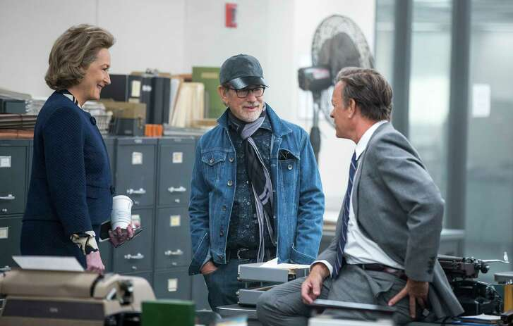 """This image released by 20th Century Fox shows actress Meryl Streep, from left, director Steven Spielberg, and actor Tom Hanks on the set of """"The Post."""" Spielberg's newspaper drama has been named the year's best film by the National Board of Review, which also lavished its top acting honors on the film's stars, Streep and Hanks. (Niko Tavernise/20th Century Fox via AP)"""
