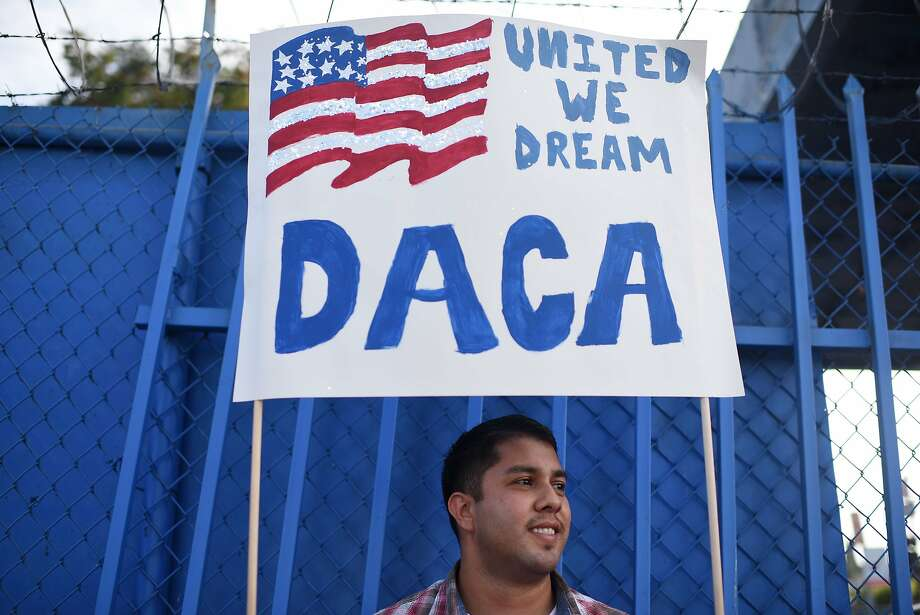 (FILES) This file photo taken on September 10, 2017 shows DACA recipient and appliance repair business owner Erick Marquez during a protest in support of DACA (Deferred Action for Childhood Arrivals) in Los Angeles, California. San Francisco-based Judge William Alsup issued his 49-page ruling on January 9, 2018, ordering the administration of US President Donald Trump to reinstate the Deferred Action for Childhood Arrivals program (DACA), an Obama-era program that provided legal status to young immigrants who entered the country illegally as children. / AFP PHOTO / Robyn BeckROBYN BECK/AFP/Getty Images Photo: ROBYN BECK, AFP/Getty Images