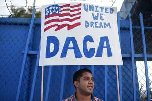 (FILES) This file photo taken on September 10, 2017 shows DACA recipient and appliance repair business owner Erick Marquez during a protest in support of DACA (Deferred Action for Childhood Arrivals) in Los Angeles, California. San Francisco-based Judge William Alsup issued his 49-page ruling on January 9, 2018, ordering the administration of US President Donald Trump to reinstate the Deferred Action for Childhood Arrivals program (DACA), an Obama-era program that provided legal status to young immigrants who entered the country illegally as children. / AFP PHOTO / Robyn BeckROBYN BECK/AFP/Getty Images