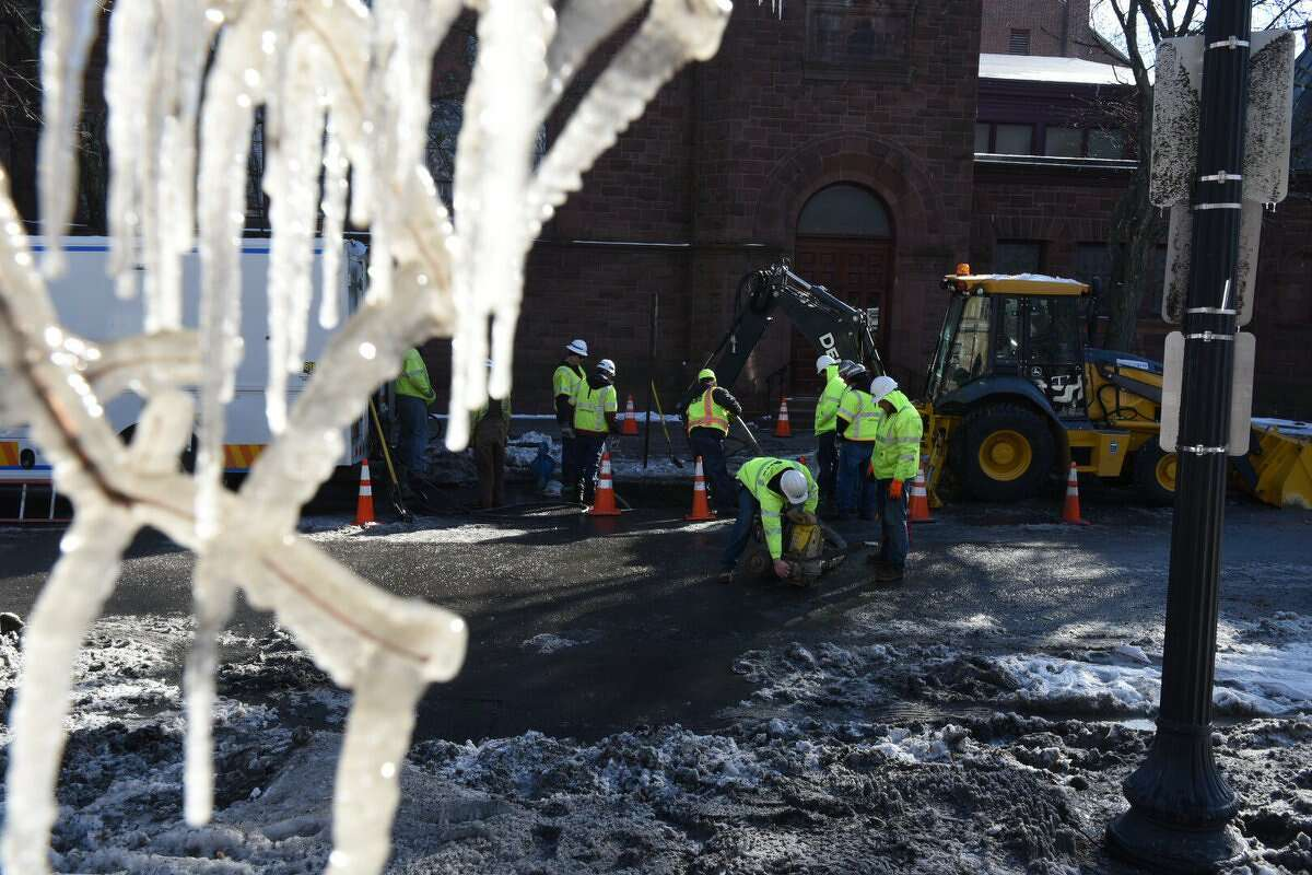 A water main broke on Wednesday, Jan. 10, 2017, at State and Willett streets in Albany, spraying water that froze on nearby trees. (Will Waldron/Times Union)