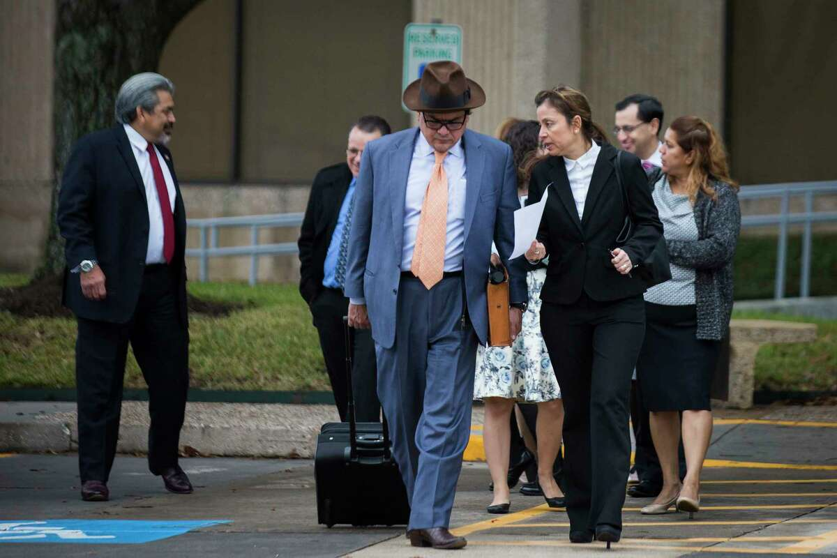 Immigration attorneys Jacob Monty and Carolina Ortuzar-Diaz exit the Immigration and Customs Enforcement offices in Houston, Wednesday, Jan. 10, 2018.