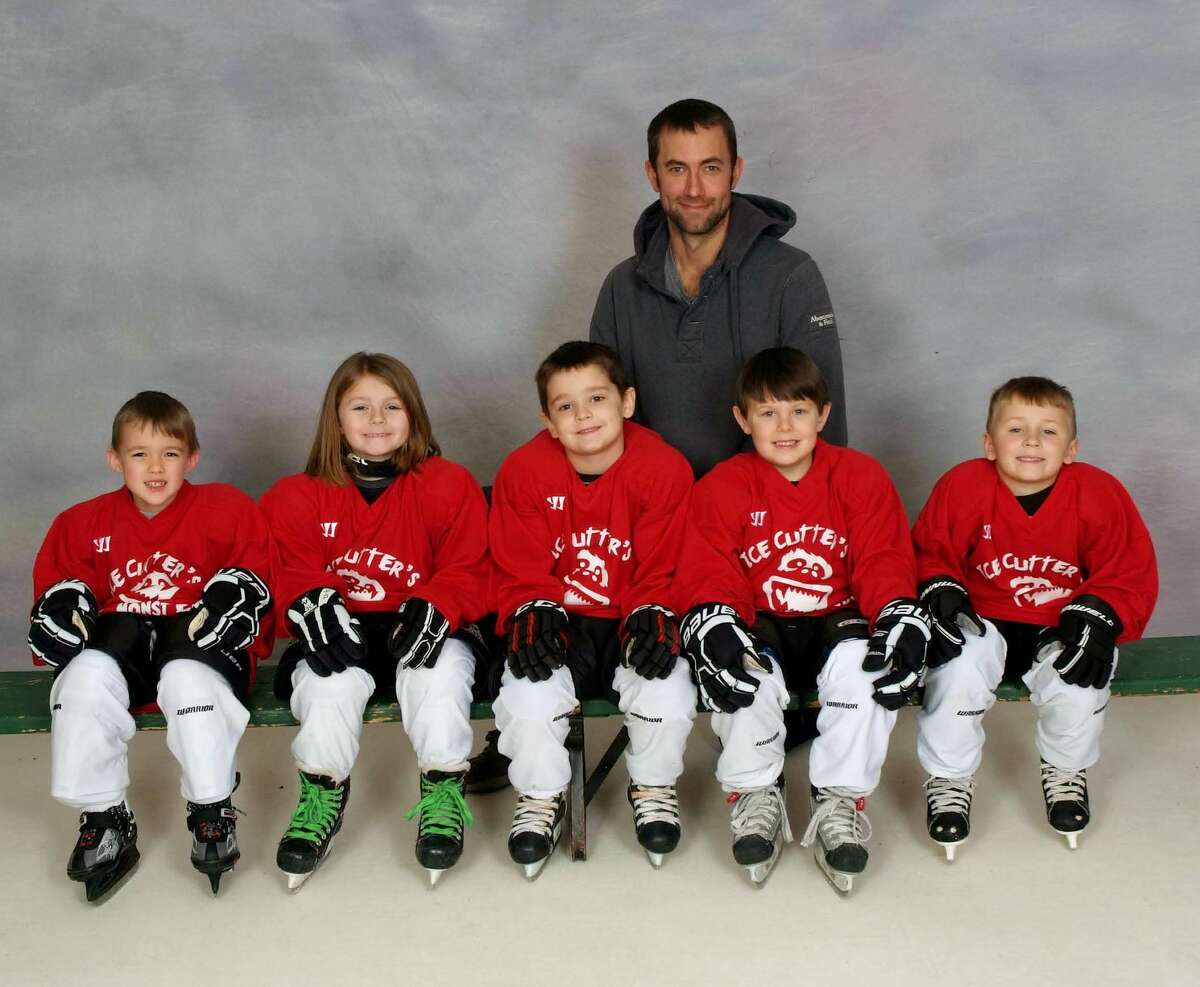 Members of the Ice Cutter's U6 Ice Monsters Red Team are (front row from left) John Krebs IV, Gracelyn Stirrett, Anthony Helser, Everett Buchholz and Brady Rice (back) coach Kyle Buchholz.